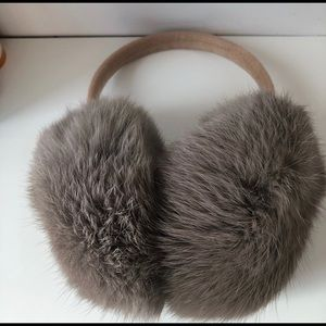 Real fur ear muff. Super soft and luxurious.